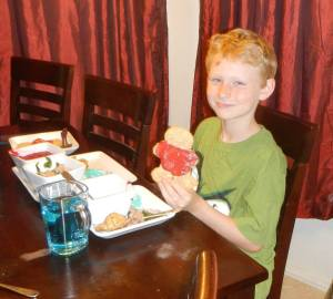 Eric eating a red-shirt cookie (the red-shirts always die!)